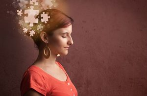 woman with puzzle pieces